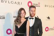 Analeigh Tipton and Jake McDorman are seen arriving to the 26th Annual Elton John AIDS Foundation's Academy Awards Viewing Party held at West Hollywood Park in Los Angeles, California.