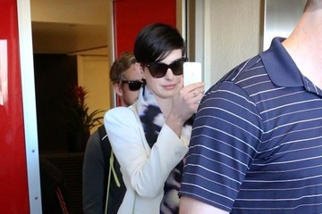 Adam Shulman Anne Hathaway and Adam Shulman at LAX