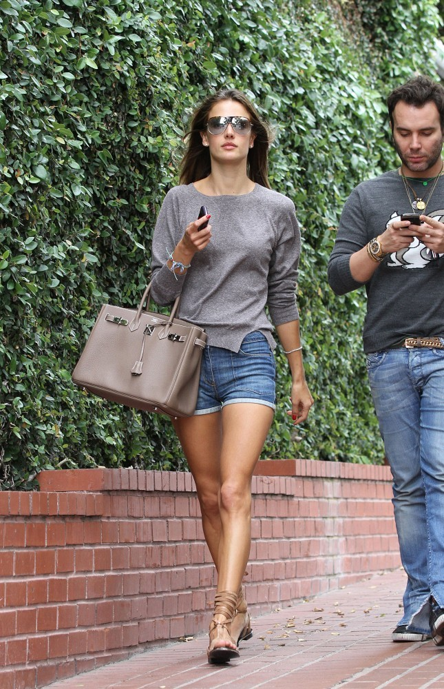 Alessandra Ambrosio wears short denim cutoffs as she  grabs some coffee with a friend  at Urth Cafe.