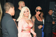 Amber Rose And Blac Chyna Enter Bootsy Bellows