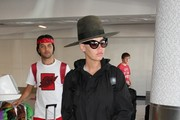 Amber Rose Goes to LAX in a Big Hat