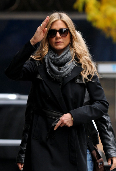 Jennifer Aniston waves as she arrives on the set of 'Wanderlust' in Midtown.
