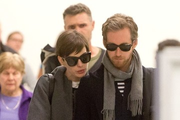 Anne Hathaway Anne Hathaway and Adam Shulman at the Airport
