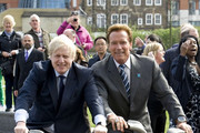 "Arnold Schwarzenegger meets with London mayor Boris Johnson and joins him for a ride around City Hall in his popular ""Boris bikes."" ."