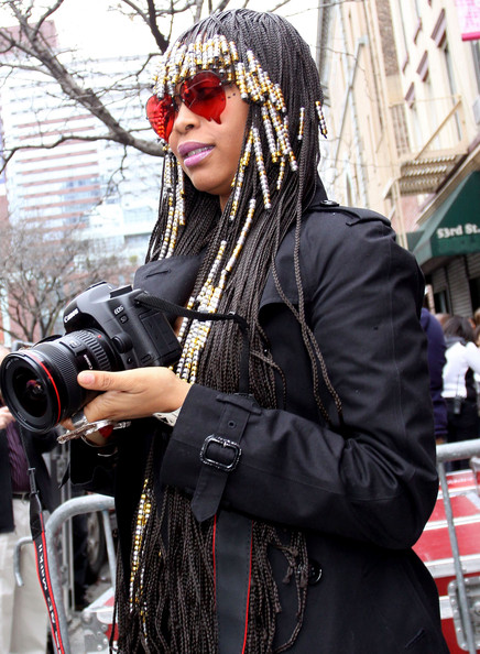 "Singer Erykah Badu leaves ""The Wendy Williams Show"" and grabs a camera to photograph the paparazzi."
