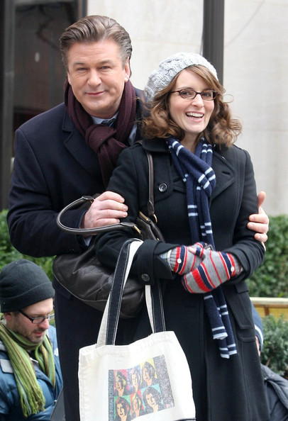 "Alec Baldwin and Tina Fey bundle up to  stay warm as they film scenes for ""30 Rock"" in Rockefeller Center."