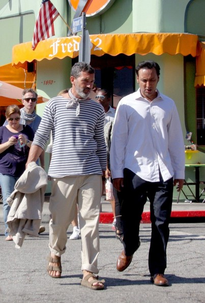 "Antonio Banderas and comedian, Aasif Mandvi, take a walk together while on break from filming the upcoming  romantic comedy, ""He Loves Me,"" in Los Feliz."