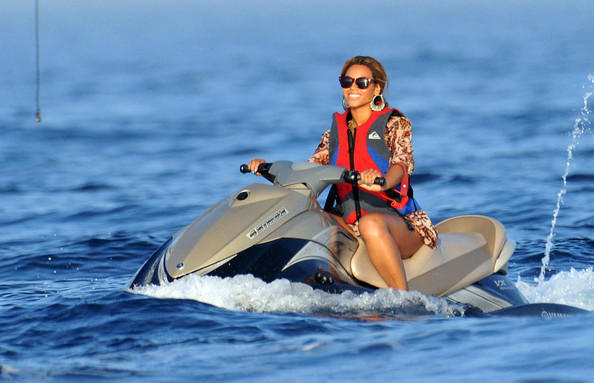 Beyonce Knowles Beyonce has some fun out on a jet ski while husband Jay-Z stays on their yacht, Altitude.
