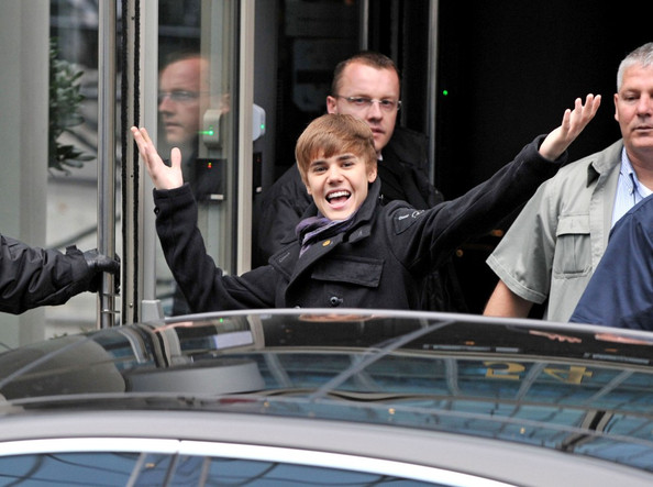 Justin Bieber arrives at the NRJ radio station with open arms for his