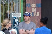 Jason Biggs and his wife Jenny Mollen dine at Joan's on Third with their six-wee-old son, Sid, and friends.