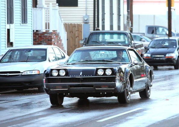 Brad Pitt drives around in a Tornado car on the set of his new movie Cogan's Trade.