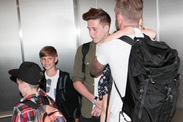 Brooklyn Beckham David Beckham and Family at LAX