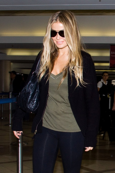 Carmen Electra looks like she's put on a couple pounds as she prepares for a departure at LAX (Los Angeles International Airport).