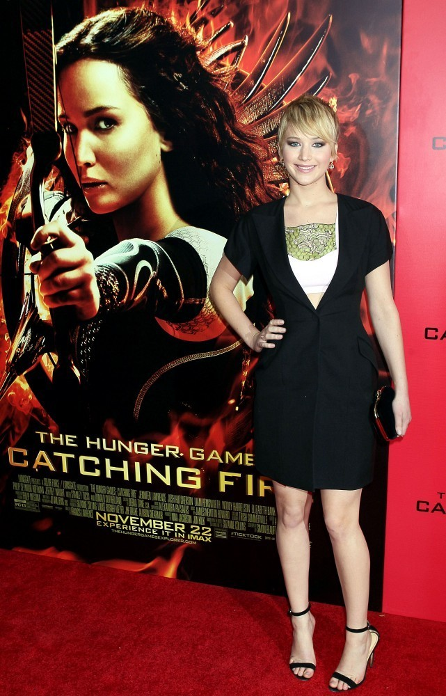 an analysis of the dystopian fiction catching fire by suzanne collins Combines (a) textual analysis of the main sources under investigation, (b) the   ethos exert over the representation of action heroines in fiction, and it notes the   suzanne collin's the hunger games trilogy (2008-‐2010) or beatrice prior in .