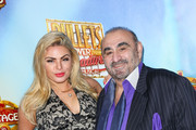Ken Davitian and Tia Barr are seen attending premiere of the 'Bullets Over Broadway' at the Pantages Theatre.