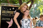 Cheryl Hines honored with a star on the Hollywood Walk of Fame on January 29, 2014.