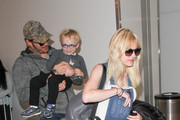 Chris Pratt, Anna Faris, and Jack are seen at LAX on May 17, 2016.