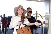 Chrissy Teigen and John Legend at LAX