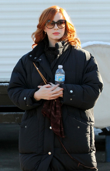 "Christina Hendricks Christina Hendricks knits and signs an  autograph as she waits to film scenes for ""I Don't Know How She Does It""."
