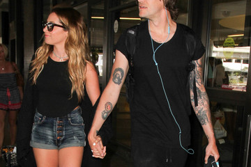 Christopher French Ashley Tisdale and Christopher French Are Seen at LAX