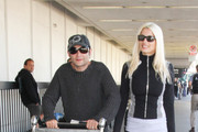 Corey Feldman and Courtney Anne Mitchell Are Seen at LAX