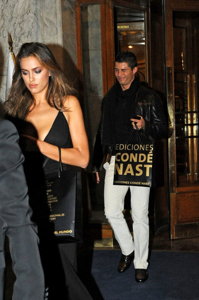 Cristiano Ronaldo Cristiano Ronaldo and girlfriend Irina Shayk leave the Top Glamour Awards at the Ritz Hotel with their gift bags in tow.