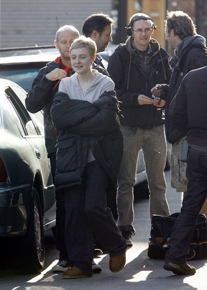 Actress Dakota Fanning and Olivia Williams are seen on the set of their latest project Now Is Good. The film is about a girl called Tessa who is dying of leukaemia who compiles a list of things she'd like to do before passing away. In the scene being shot Tessa's love interest has scrolled her name in graffiti in her local area, in an attempt to woo his dying love!.