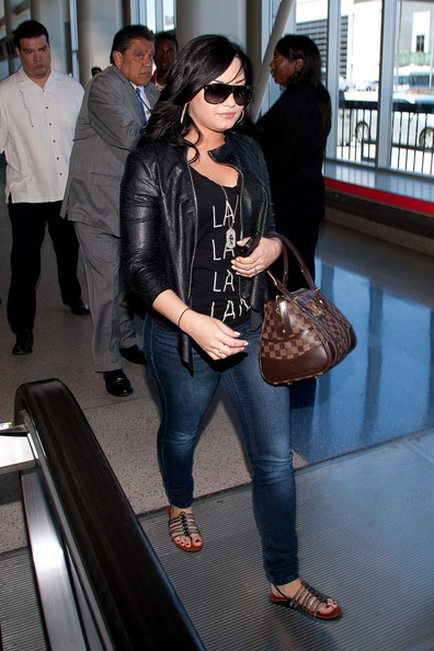 ****NO GERMANY / SWITZERLAND****.Demi Lovato prepares to depart LAX (Los Angeles International Airport) wearing an LA T-Shirt. Demi is also selected for the Full Body Scan in TSA.