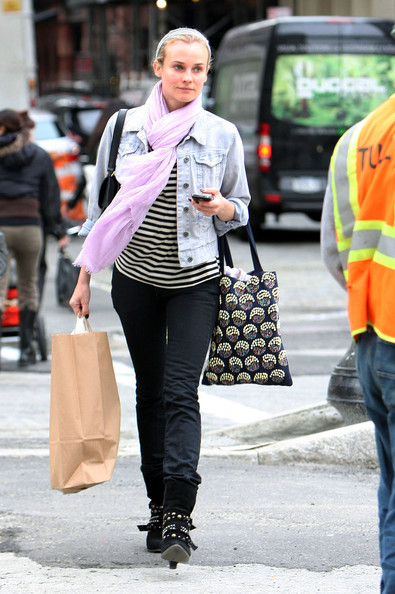 Diane Kruger Actress Diane Kruger wears a pretty purple scarf as she shops around Soho.