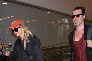 Doyle Bramhall Renee Zellweger and Doyle Bramhall Spotted at LAX