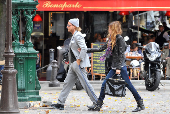 Lapo Elkann enjoys a walk with his girlfriend, Bianca Brandolini, after parking his matte black Maserati on the street.
