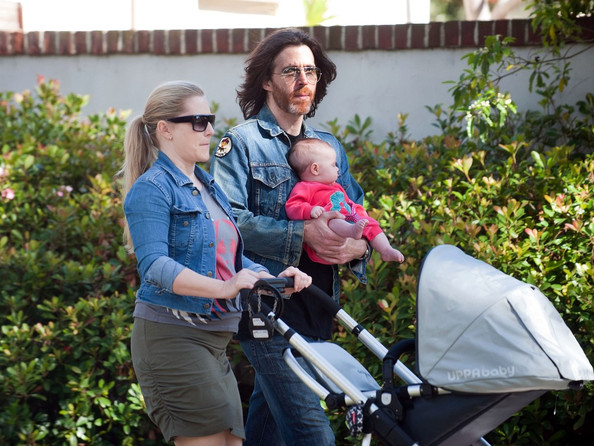 Emily Procter and her boyfriend Paul Brayan with their daughter Pippa