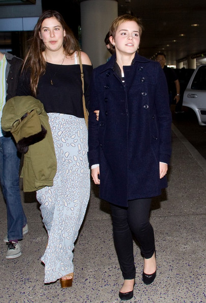 Emma Watson and friends arrive at LAX (Los Angeles International Airport) just in time to celebrate the New Year.