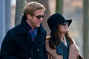 Eva Mendes and Ryan Gosling spend their day walking through Pere Lachaise cemetery.  They couple holds hands and laugh as they take in the beauty of the area, and at one point they sneek behind a monument to steal a kiss with each other.