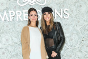Tiffany Brower and Olga Safari are seen attending the Gretchen Christine x Impressions Vanity PopUpParty at Impressions Vanity in West Hollywood in Los Angeles, California.