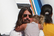 Foo Fighter's frontman, Dave Grohl, takes his little girls to the pumpkin patch in Beverly Hills. While there oldest daughter Violet Maye (b. April 15, 2006) has to be carried down the slide, and comforted by her dad. Later Grohl totes youngest daughter Harper Willow (b. April 17, 2009).