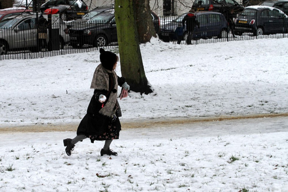 English actress Helena Bonham Carter her partner director Tim Burton and their children Billy Raymond Burton, (b. 4 October 2003) and Nell Burton, (b. 15 December 2007) play in the snow in Primrose Hill.