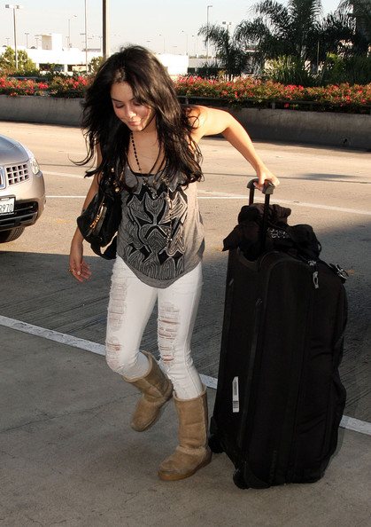 Vanessa Hudgens wears shredded jeans as she makes her way into the terminal at Los Angeles International Airport (LAX) to catch a flight out.