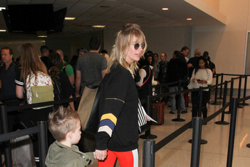 January Jones January Jones and Her Family Are Seen at LAX
