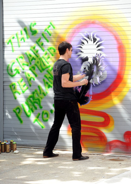 "Jim Carrey Jim Carrey is in a playful mood and smiles as he paints ""graffiti"" on his West Village studio's door."