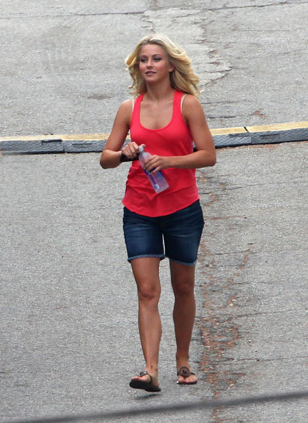 "Julianne Hough walks around the new ""Rock of Ages"" film set wearing an orange vest and denim shorts as she continues filming with co-stars Russell Brand and Diego Boneta."