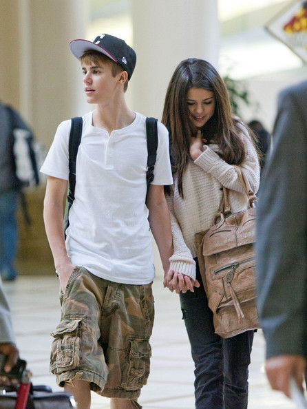 Justin Bieber ***NO WEB/BLOG WITHOUT PRIOR APPROVAL FROM RANDY BAUER - bauergriffinsales@gmail.com ***.Justin Bieber and Selena Gomez together in Los Angeles, smiling and holding hands after a winning night for Bieber at the Billboard Music Awards.