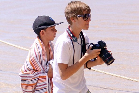 16 year old Canadian singing sensation Justin Bieber plays 2 sold-out concerts in Honolulu.Just before the first concert he does an interview with Maira Menounos (grey striped top) for the TV show Access Hollywood.The next day he goes for a boat ride on a catamaran called 'Mai Tai' with Jayden Smith and Jasmin Villegas .