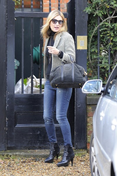 Kate Moss shows her love for Valentine's Day by wearing a 'love' tag on her necklace, as the supermodel heads to Paris on the Euro Star.