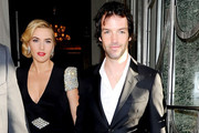 Kate Winslet and her boyfriend Ned Rocknroll hold hands as they exit their hotel and head to the premiere of 'Titanic in 3D'.