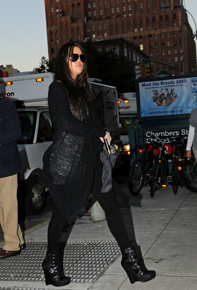 Khloe and Kim Kardashian head back to their downtown hotel.