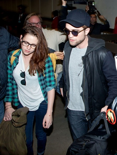 Kristen Stewart and Robert Pattinson arrive at LAX (Los Angeles International Airport).