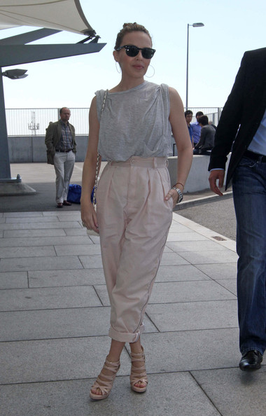 Kylie Minogue looks casual as she arrives at Heathrow International Airport T5.