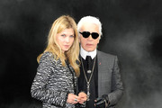 Designer Karl Lagerfeld poses with various guests ahead of the Chanel Ready-to-Wear Fall/ Winter 2011-2012 show held at Grand Palais as part of Paris Fashion Week.