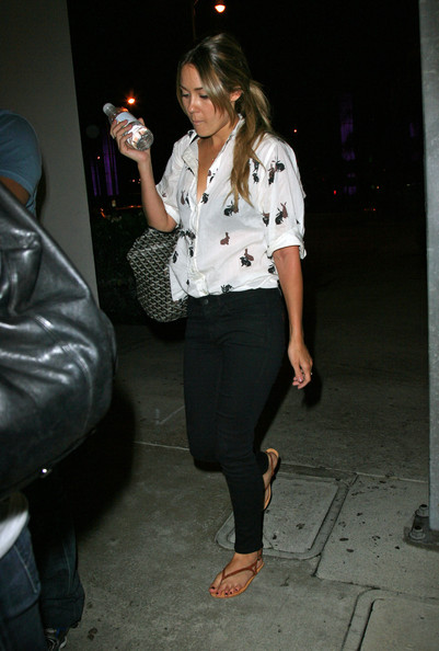 Lauren Conrad Lauren Conrad looks tired upon her 2AM arrival at Los Angeles International Airport (LAX) and even tries to shield herself from cameras with her water bottle.